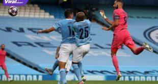 Penyerang Real Madrid, Karim Benzema cetak gol lewat heading ke gawang Manchester City. FOTO : NET
