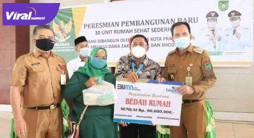 Ridho Yahya Walikota Prabumulih hadiri acara penyerahan kunci rumah dari BAZNAS dan TASPEN. FOTO : VIRALSUMSEL.COM